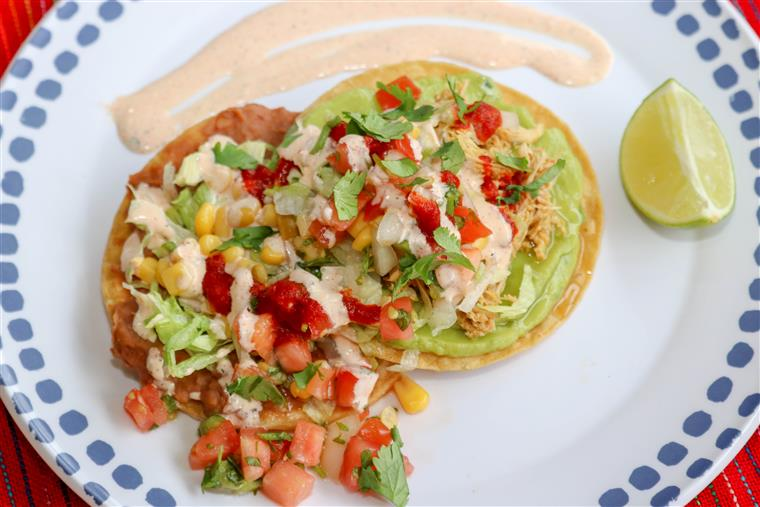 tostadas on a plate with veggies and toppings
