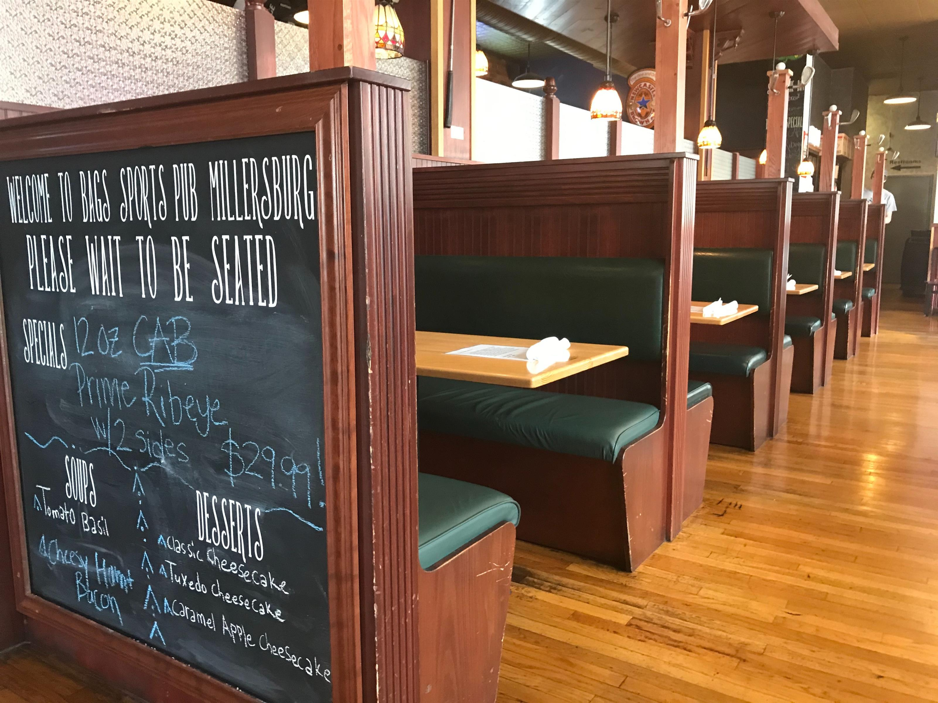 booth seating inside Bags with a chalkboard wall