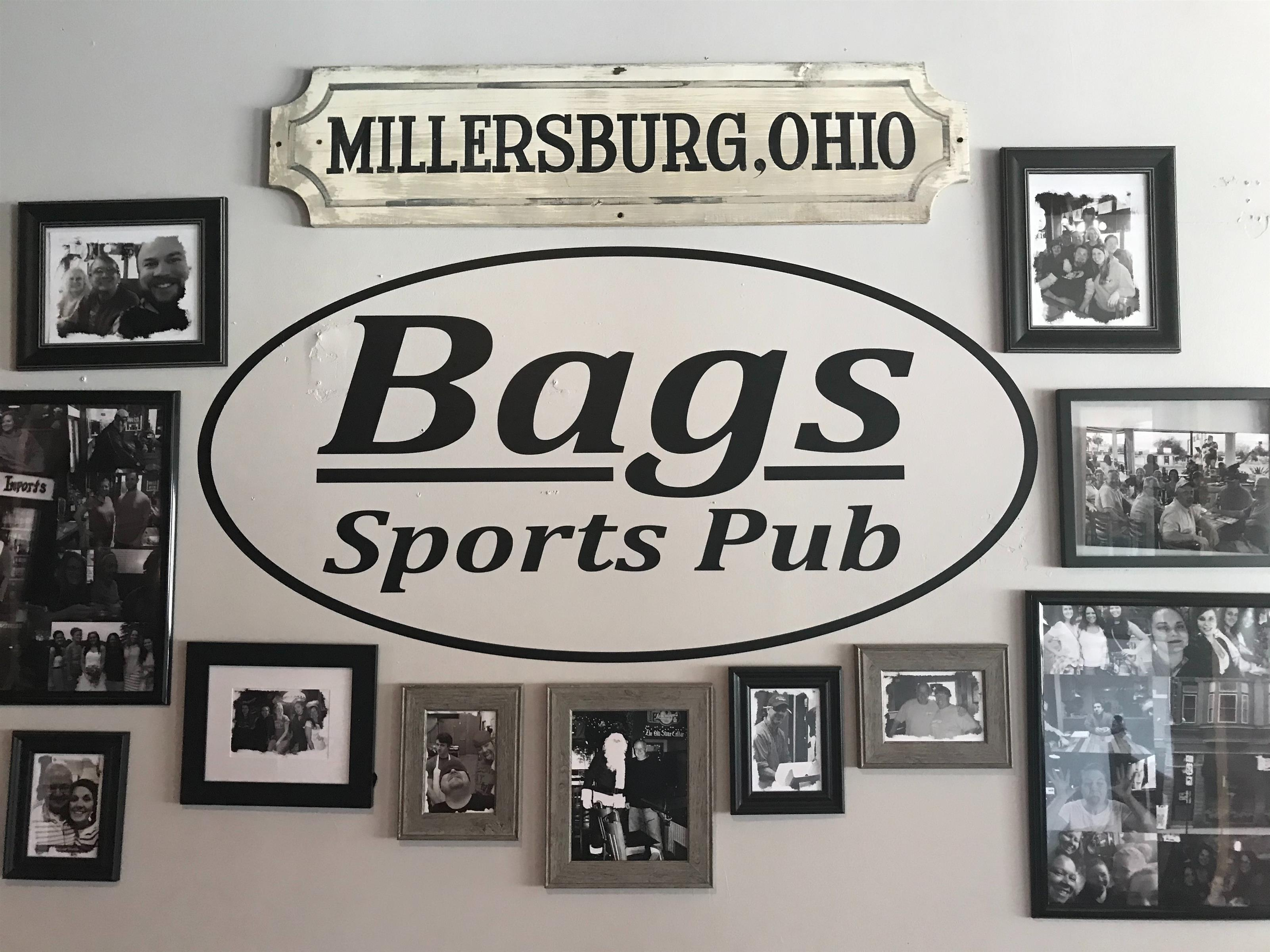 gallery wall with a Bags Sports Pub sign and a Millserburg, Ohio sign