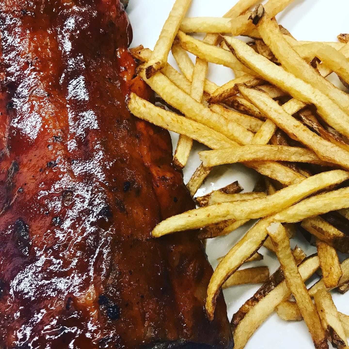 BBQ Baby Back ribs with side of french fries
