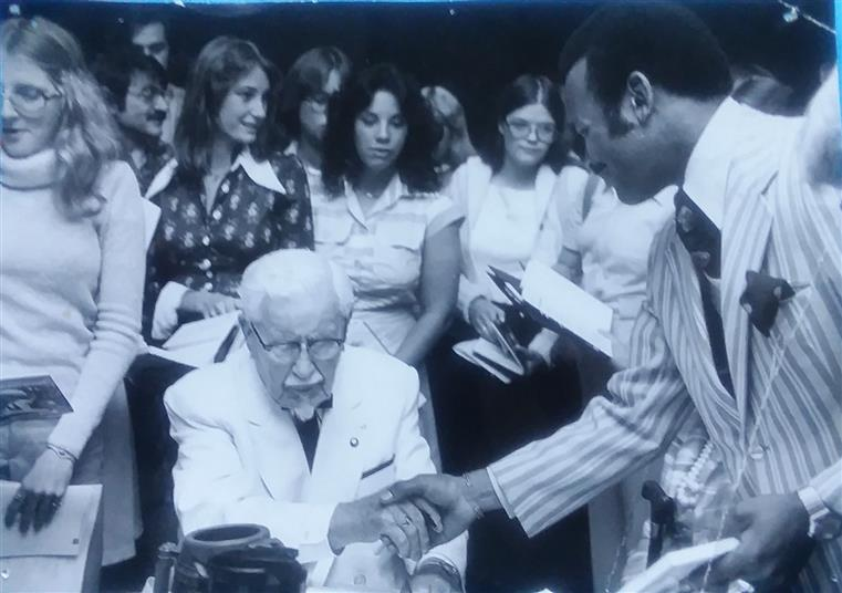 "Colonel Harland Sanders ""Finger-Lickin' Good"" book signing event. Keith White with Restaurant Staff. Minneapolis, MN February 1977"