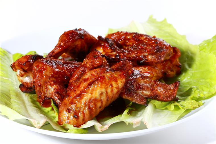 chicken wings tossed in barbecue sauce
