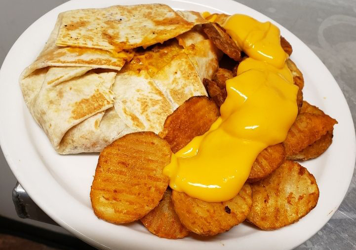 homemade crunch wrap with potato slices and nacho cheese