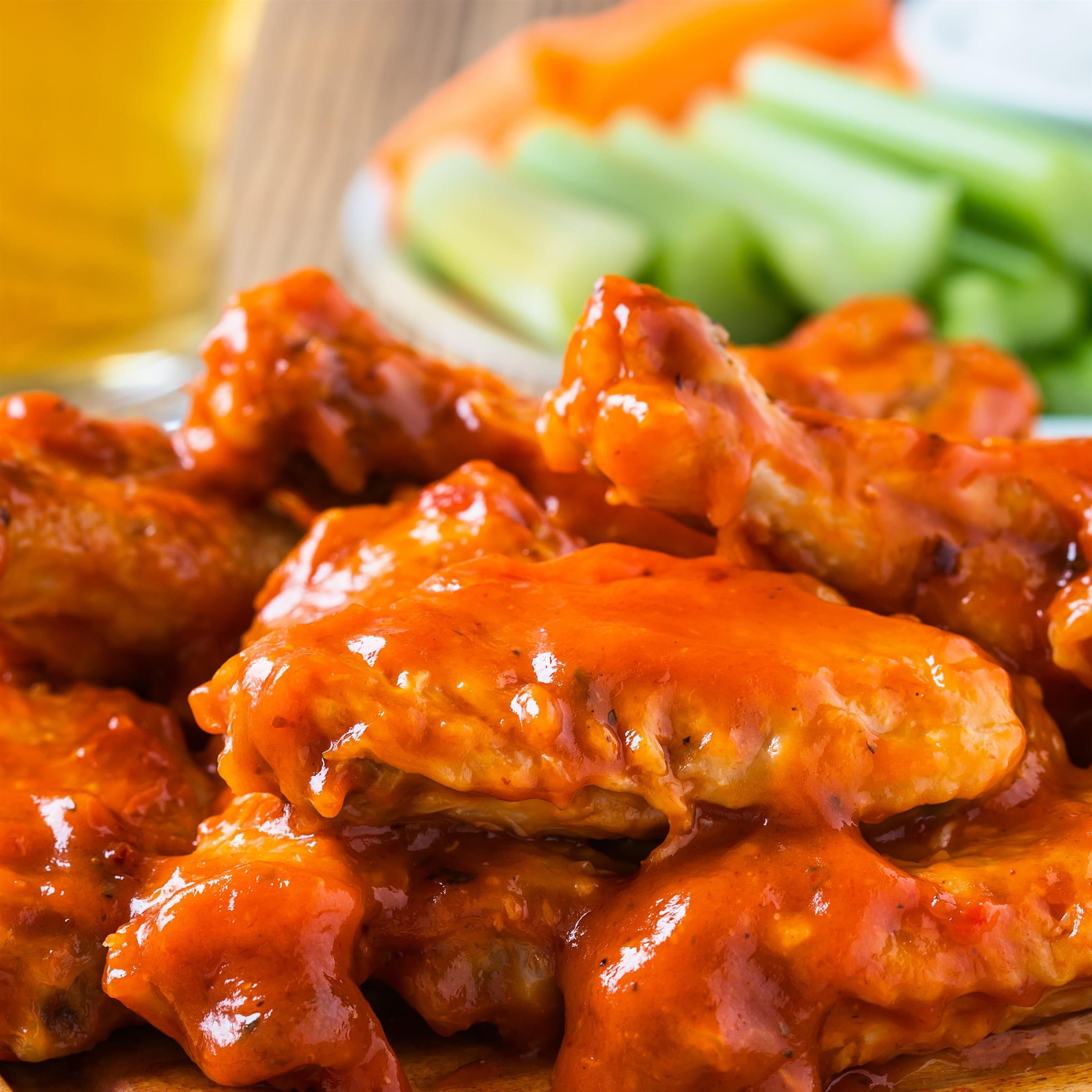 buffalo chicken wings with celery, carrots and blue cheese on the side