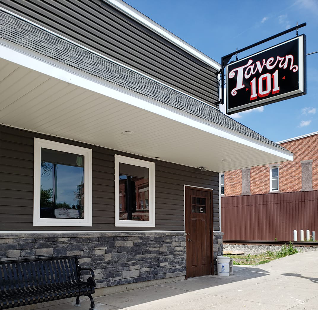 exterior of the building with sign that says Tavern 101