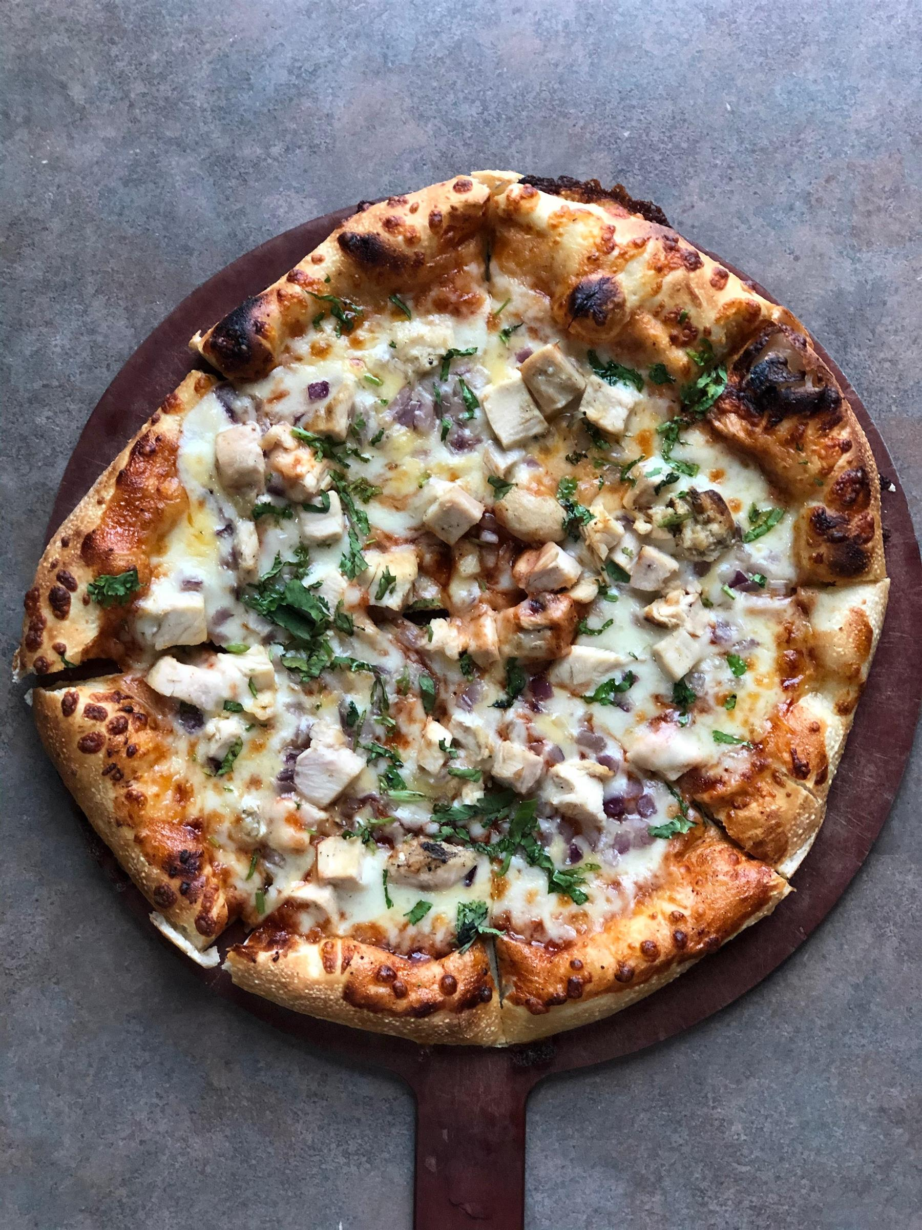 barbecue chicken pizza with onions and parsley