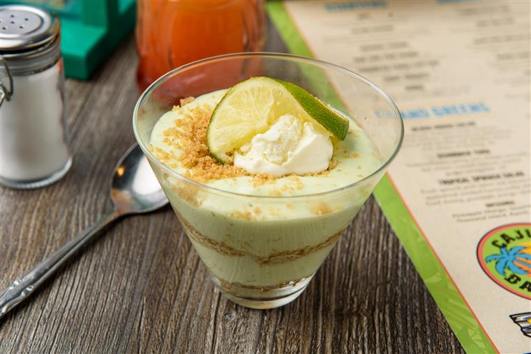 Key Lime Pie in a cup with lime slice on top