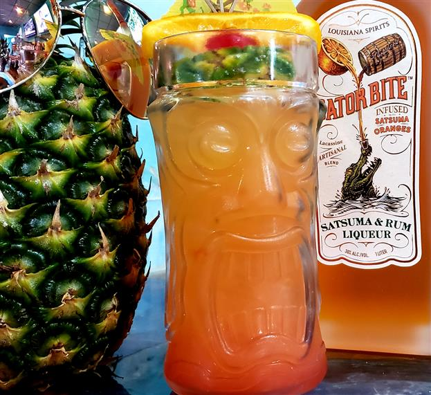 rum punch cocktail garnished with fruit