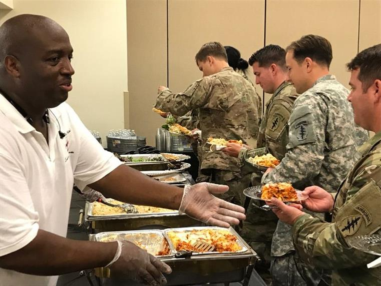 chef James of Cafe de Belton serving food to army soldiers