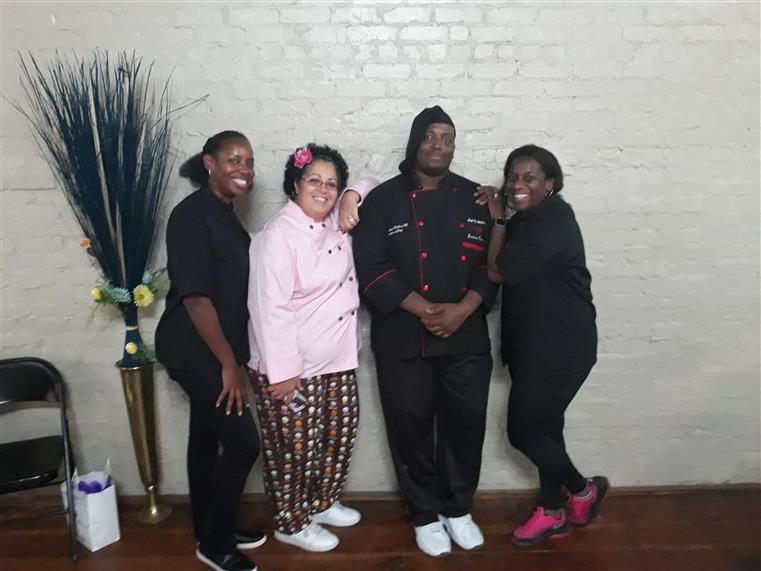 group picture of chef James with three women