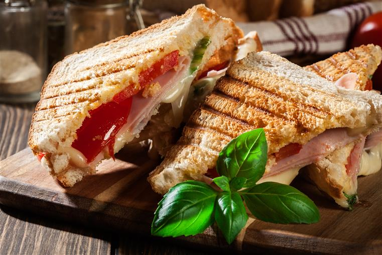caprese panini: panini with tomato, melted provolone and mozzarella cheeses, and lettuce