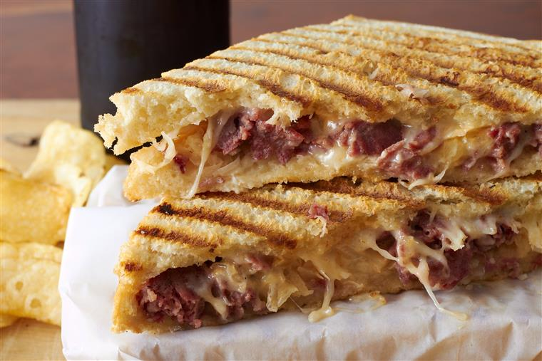 reuben panini with side of potato chips
