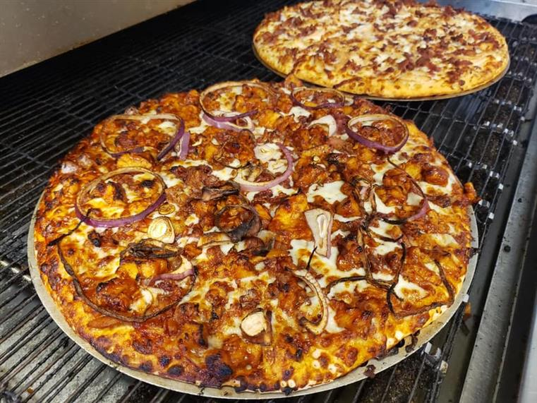 two large pizzas with assorted toppings