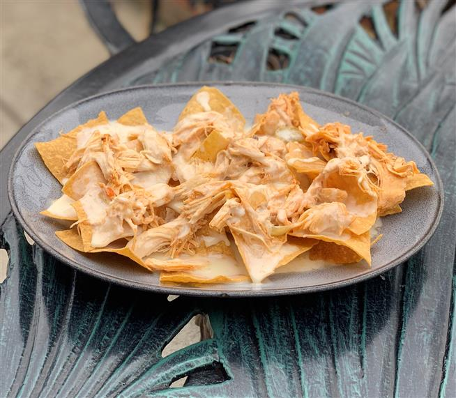 pulled chicken nachos with melted cheese.