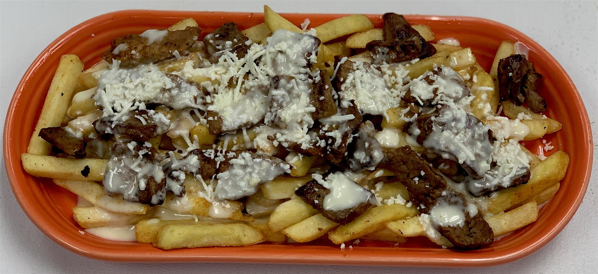 Carne Asada Fries: Fries, steak, cheese sauce and sprinkled cheese
