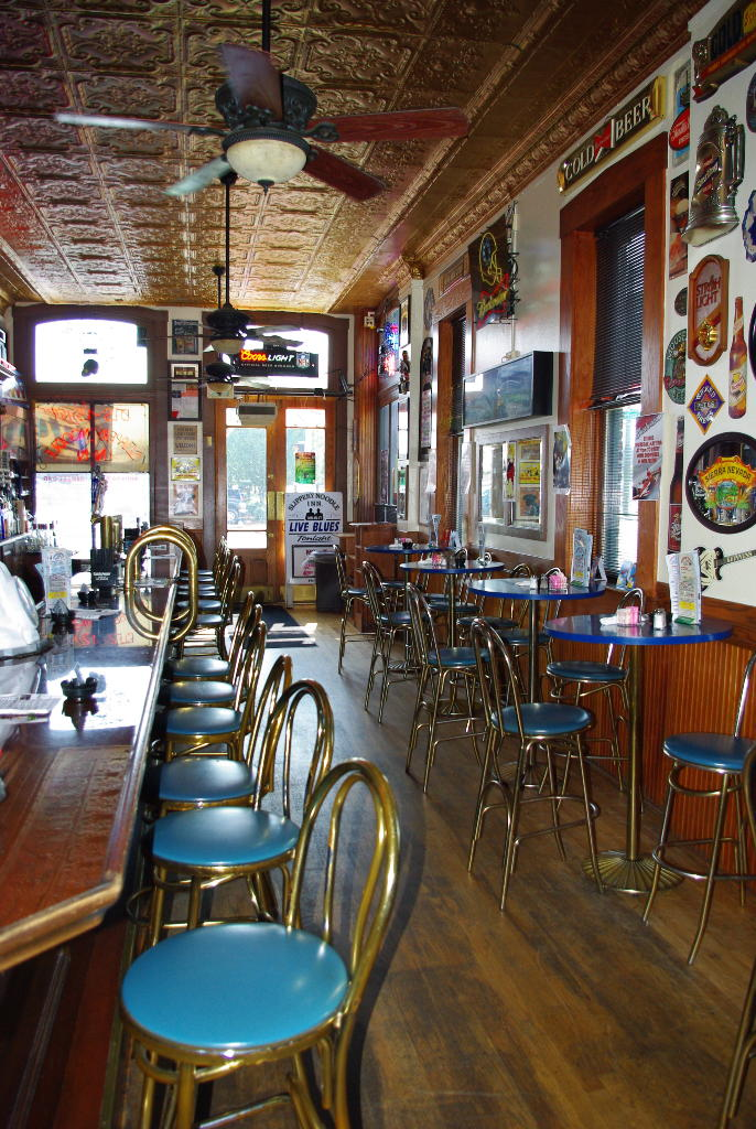 the front bar of the slippery noodle with view of tables and chairs