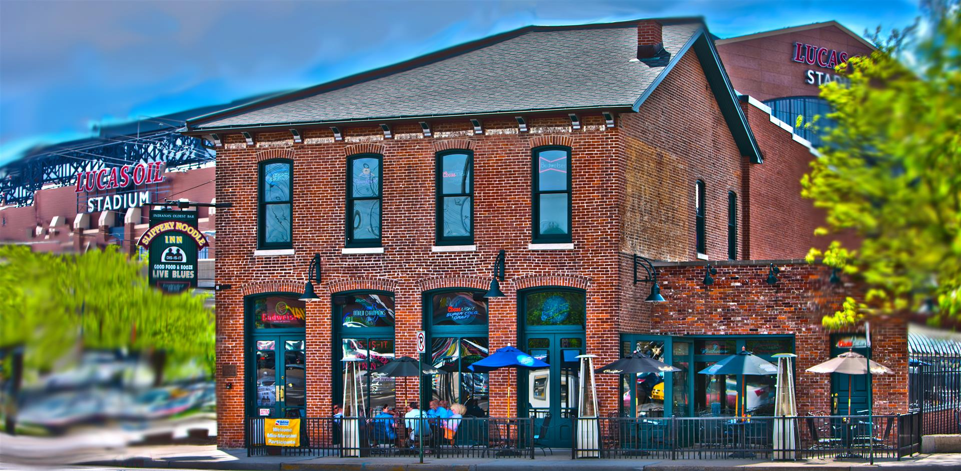 exterior of the slippery noodle inn with lucas oil stadium in the background