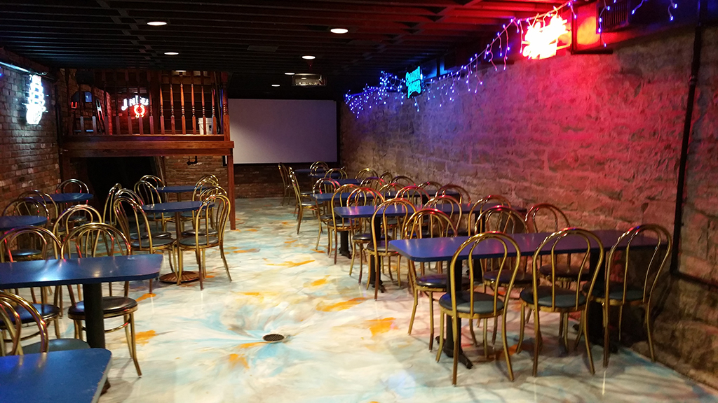 the downstairs atrium with christmas lights, a bar, tables and chairs