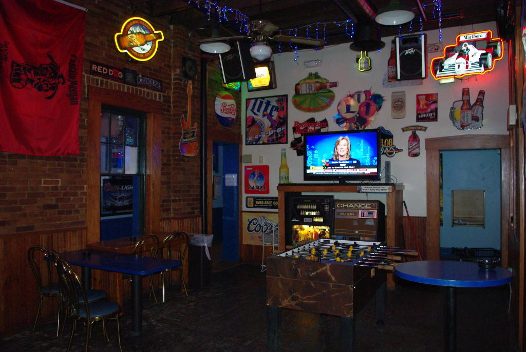 the game room with a TV, a foosball table, and tables