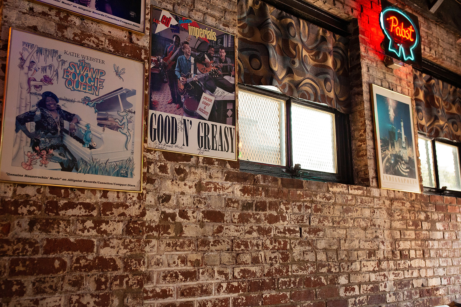 framed band posters on wall