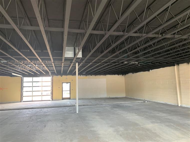 open warehouse under construction. soon to be twisted district brew co.
