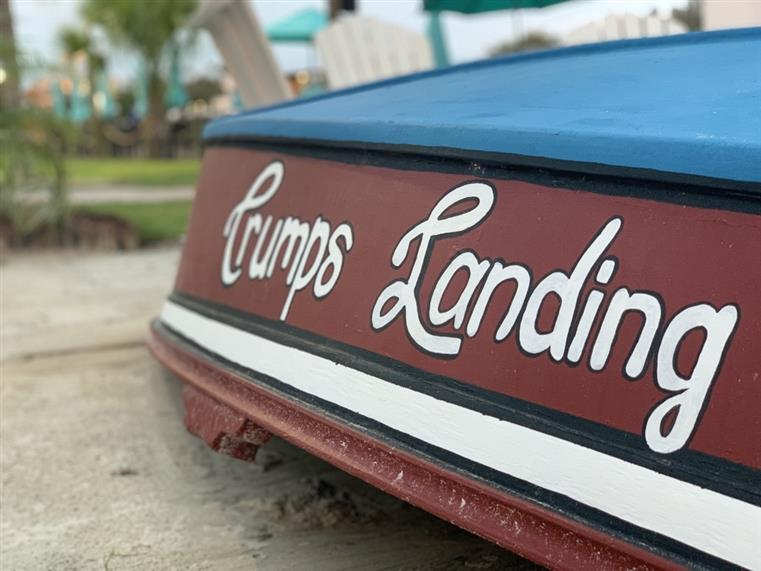 """Crump's Landing"" painted on the side of a boat"
