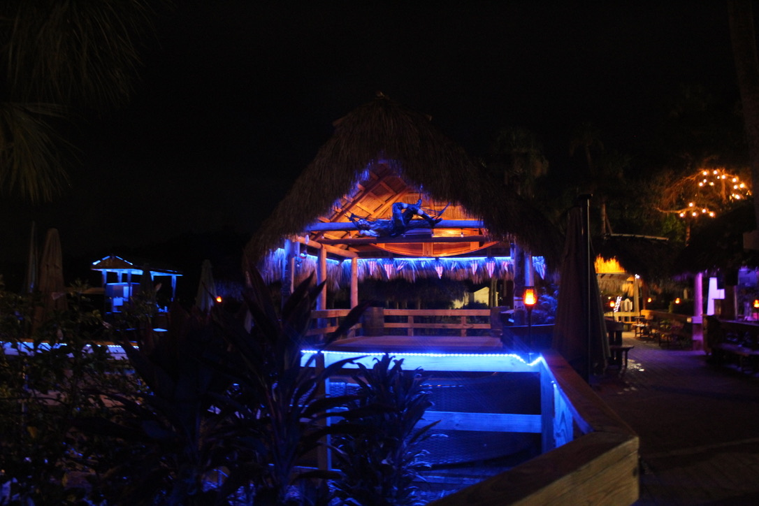 view of a crumps tiki hut at night