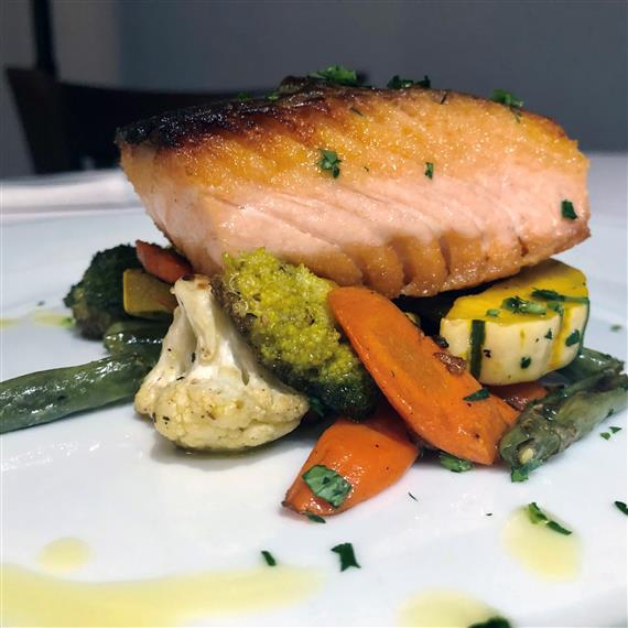 Grilled salmon over roasted vegetables