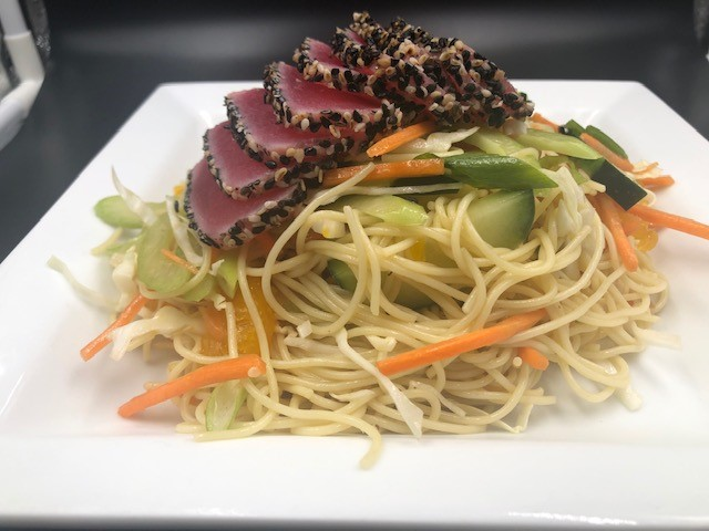 seared ahi tuna over noodles