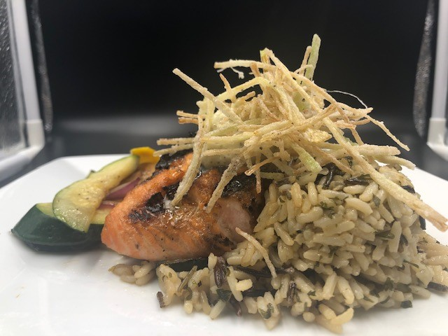 grilled salmon over wild rice with mixed vegetables