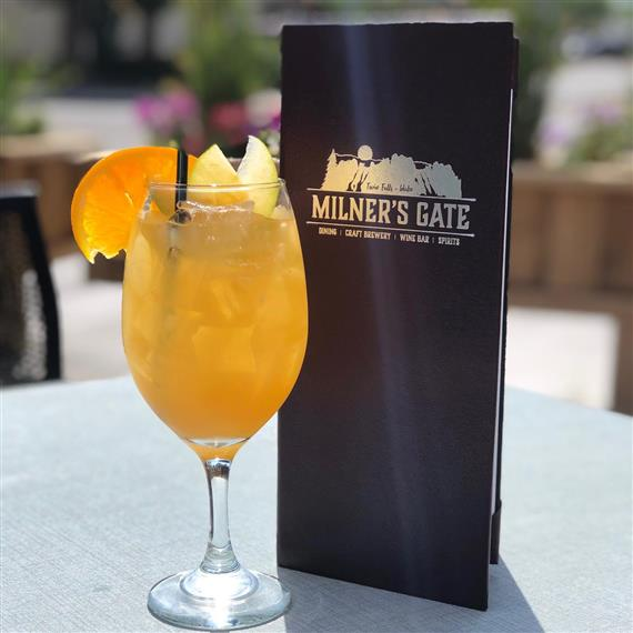 glass of white sangria with a Milner's Gate menu