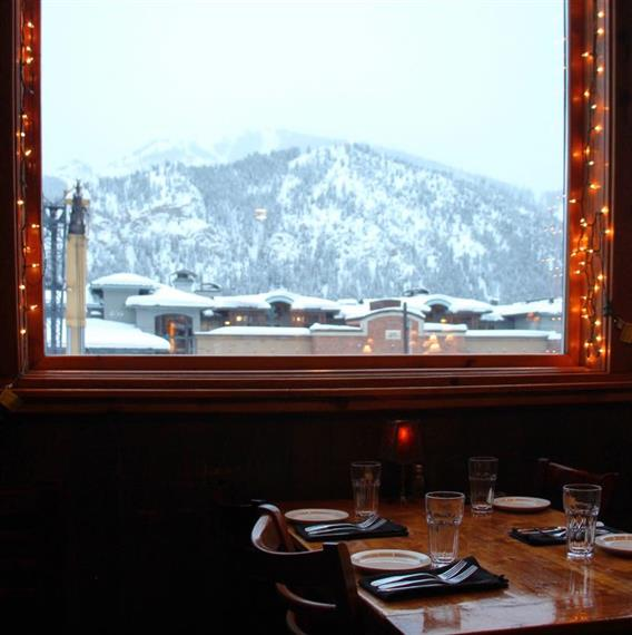 dining table in front of a window with a mountain view