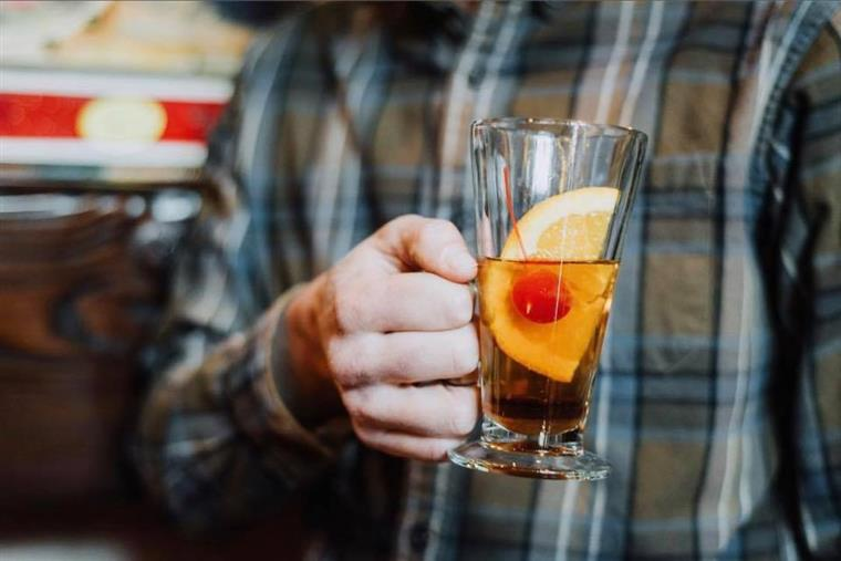 man holding a whiskey sour