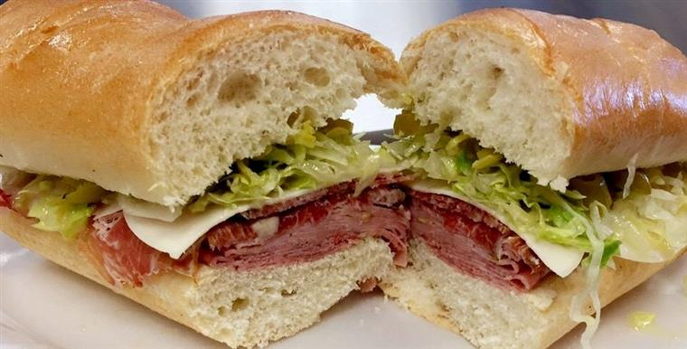 italian sandwich with meats, cheeses, lettuce and peppers