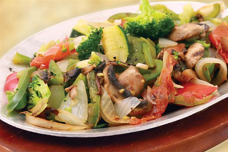 chicken and vegetable fajitas on a skillet