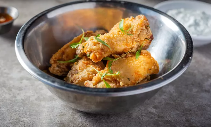 crispy jumbo wings tossed in your choice of spicy buffalo or orange glaze