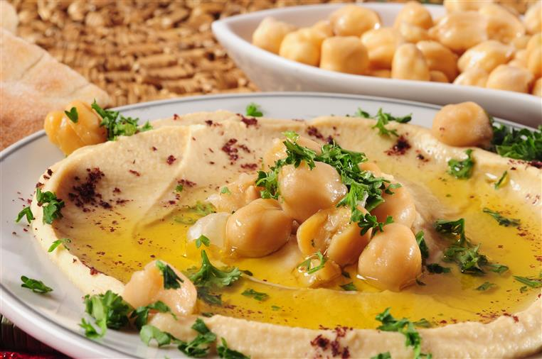 bowl of hummus topped with chickpeas