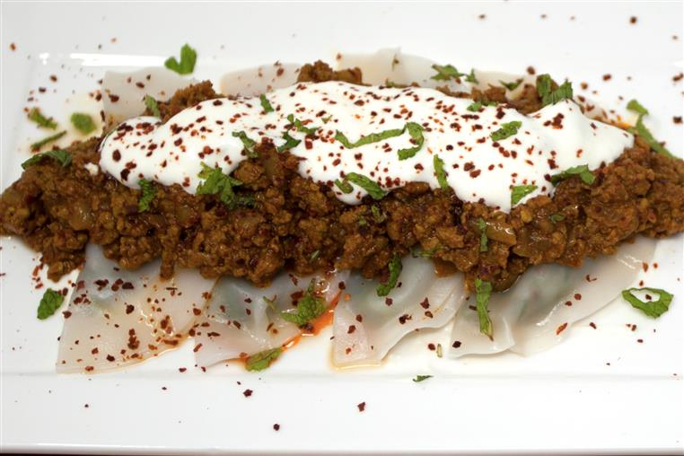 AUSHAK: Thin dumplings filled with leeks and spring onions sprinkled on top with our meat sauce, garlic-yogurt and mint