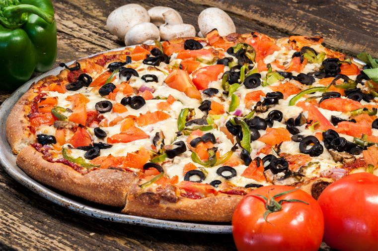 veggie pizza; pizza topped with black olives, tomatoes, peppers and onions
