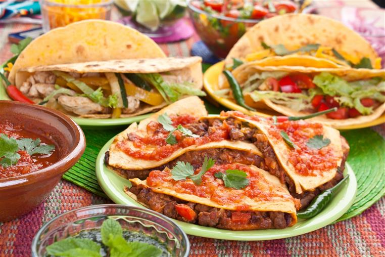 various mexican dishes on plates