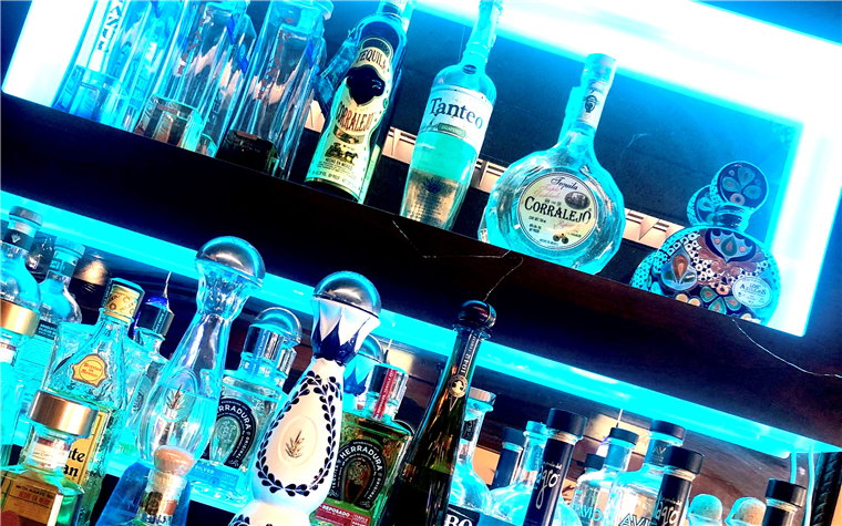 assorted tequila bottles on a shelf