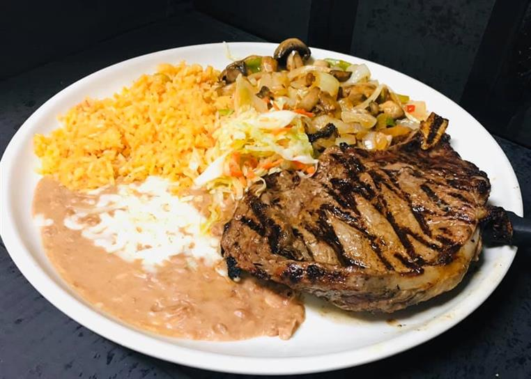 porkchop with beans, rice, and vegetables