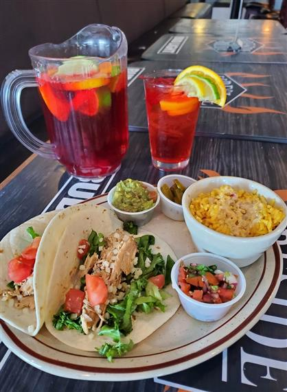 two chicken tacos and a pitcher of sangria