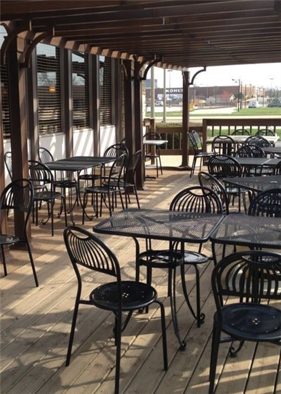 Outdoor deck with table and chairs