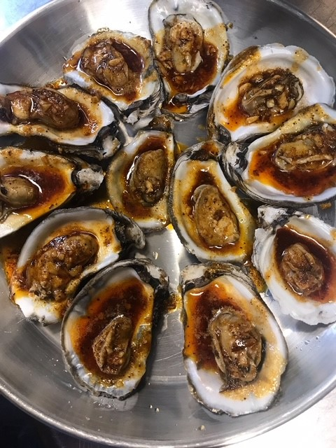 raw oysters on the half shell with special sauce