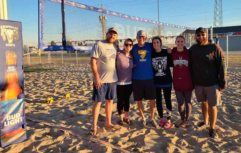 smiling customers at the buffalo chipz beach volleyball court