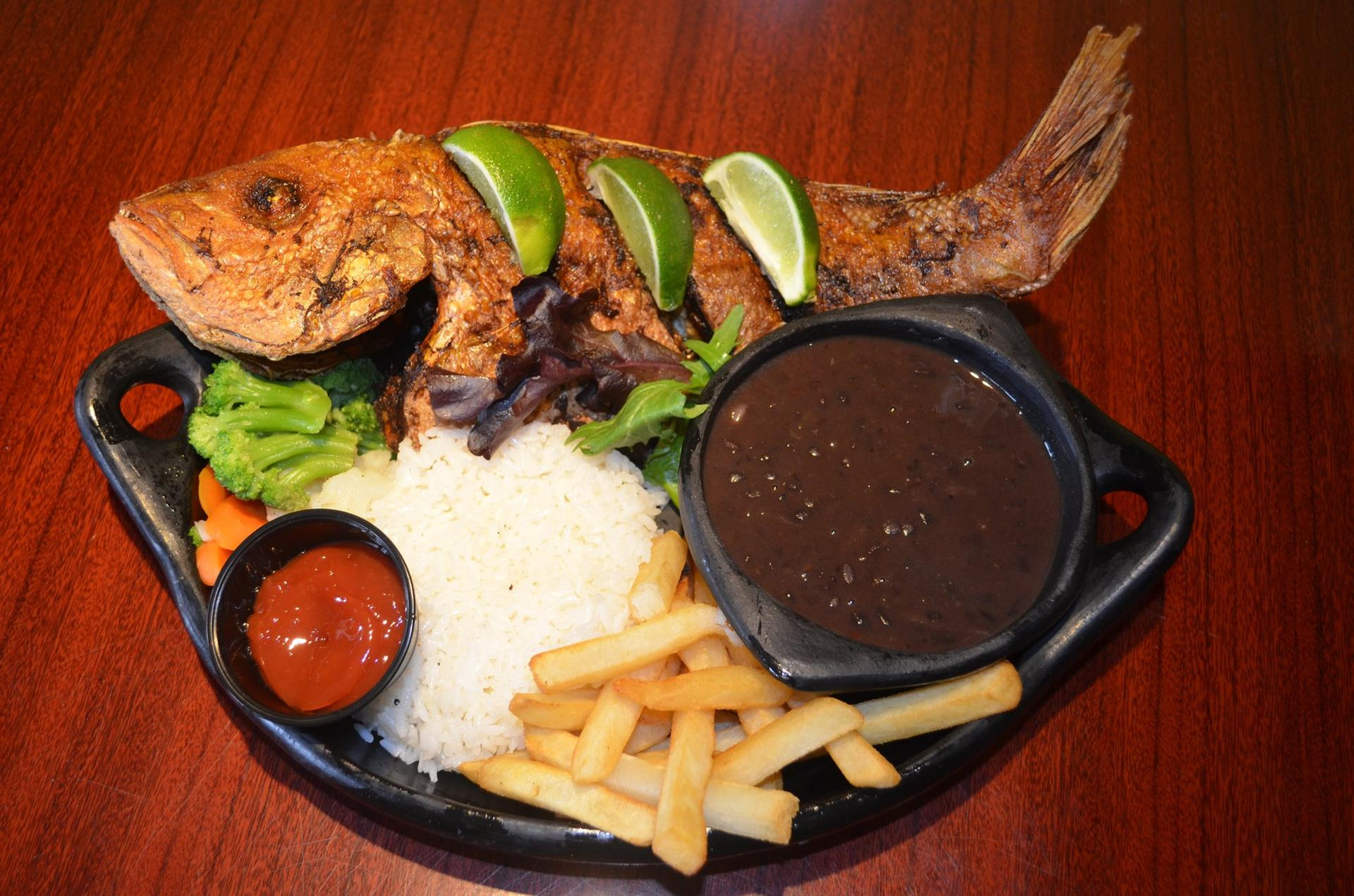 Pargo Rojo Frito: Whole fried red snapper. Served with white rice, green plantains, fried yuca, & a house salad.