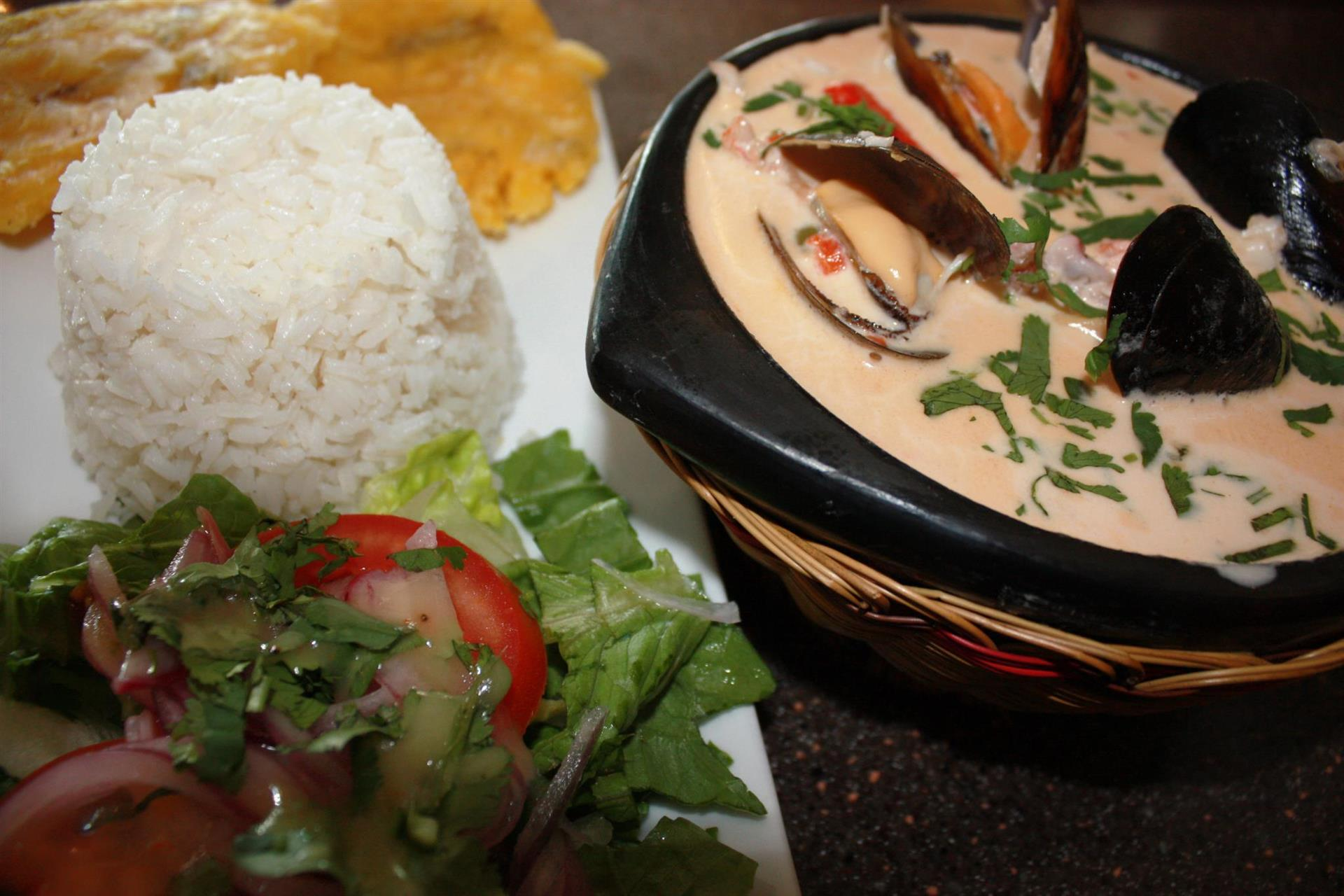 Cazuela De Mariscos: Seafood chowder. Served with white rice & a house salad.