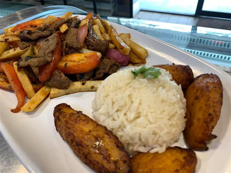 Lomo Saltado: Skirt steak, stir fried onions, tomatoes and French fries. Served with white rice & sweet plantains