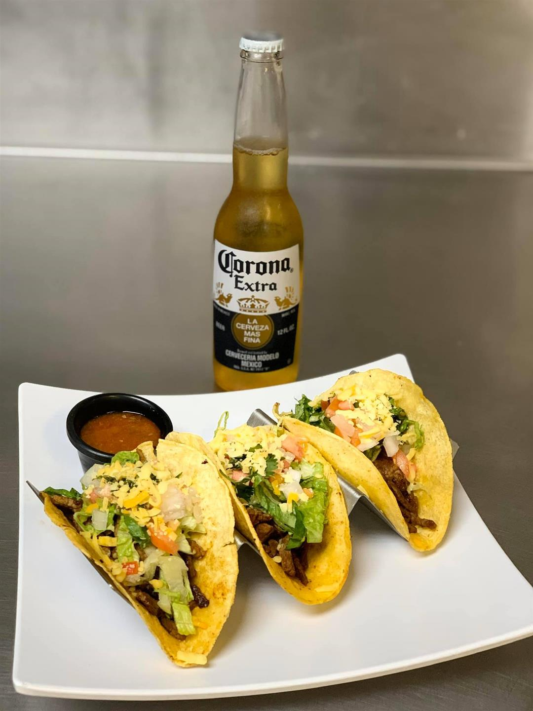 three hard shell tacos